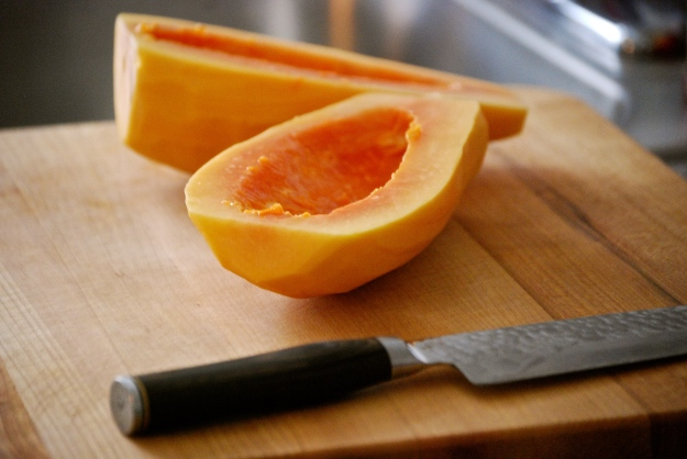 Huge fresh papaya - skin peeled off, seeds removed, cut in half