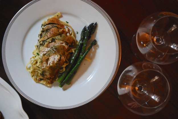 Plated meal, sliced breast meat, tagliatelle, asparagus