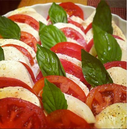 Fresh mozzarella shingled with ripe beefsteak tomatoes and basil