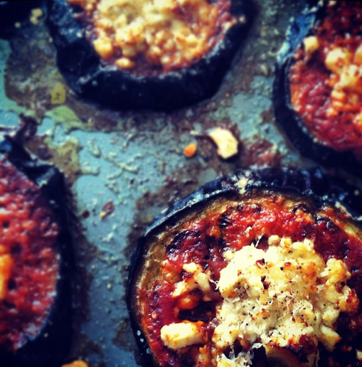 Gorgeous roasted eggplant slices topped with tomato sauce and feta
