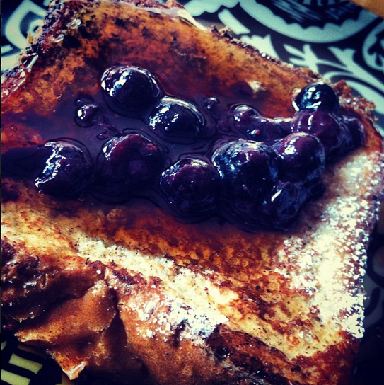 A brunch favorite, brioche french toast with Vermont maple syrup and macerated blueberries